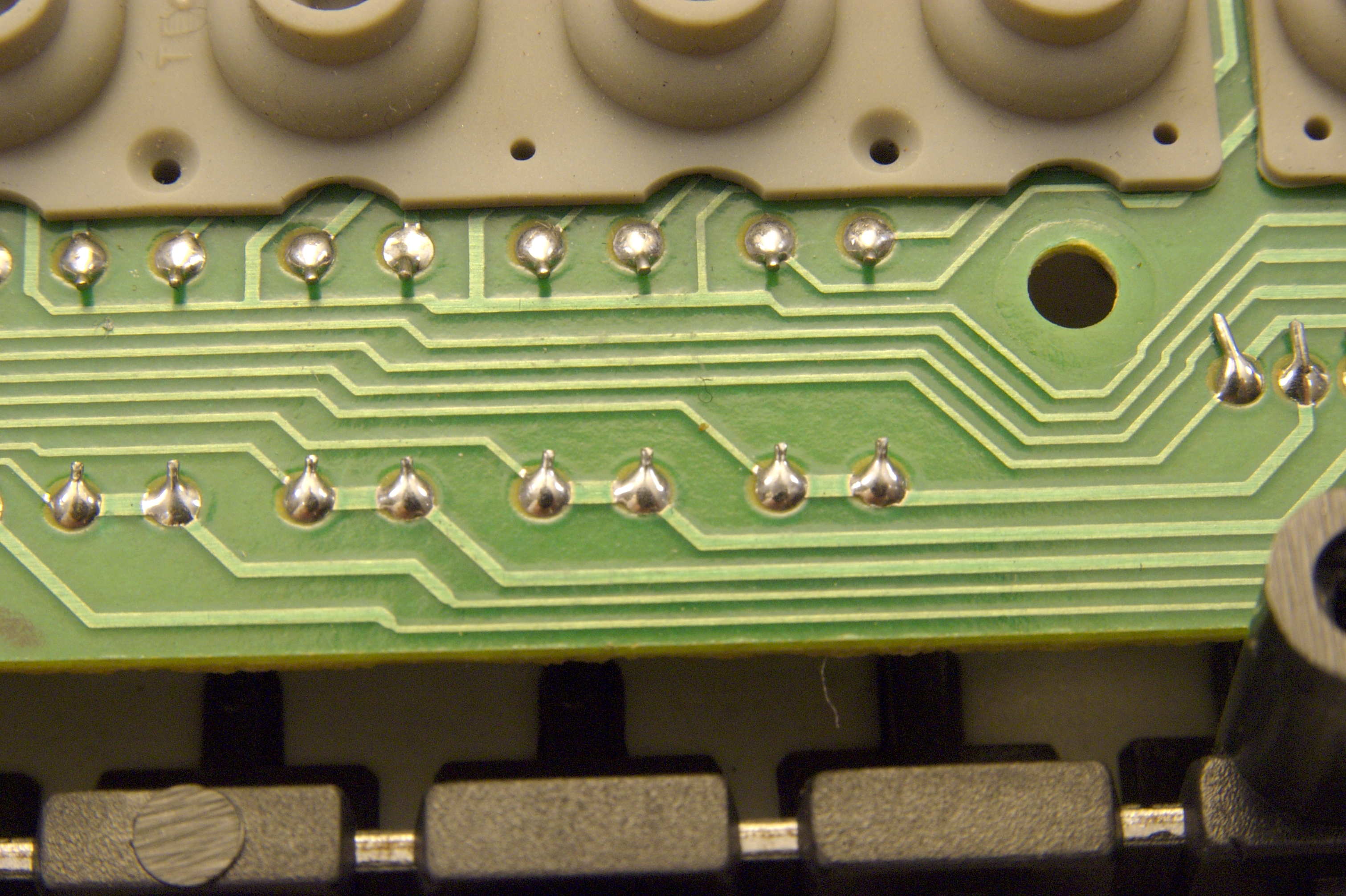 DSC_9345.jpg - There are diodes on the back of the circuit board. Here are the solder points on the top of the board.